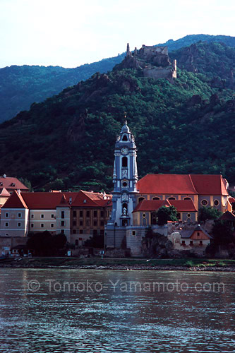 At Duernstein, a church tower dominates the landscape with castle ruins above a rocky outcrop